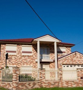 double storey brick home with blockout roller shutters
