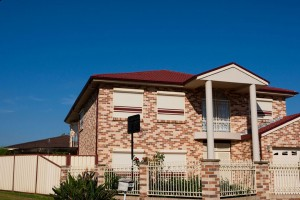 left side of double storey brick home with blockout roller shutters
