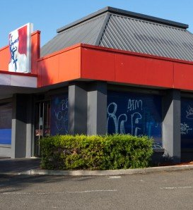 KFC store with blue window shutters