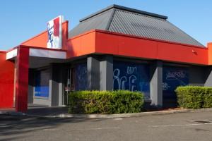 KFC store with blue window shutters