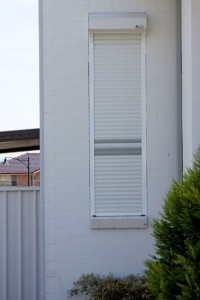 close-up of white window shutters for exterior windows