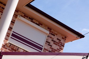 white window shutters with lines of burgundy