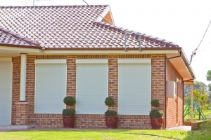 house with domestic roller shutters side view